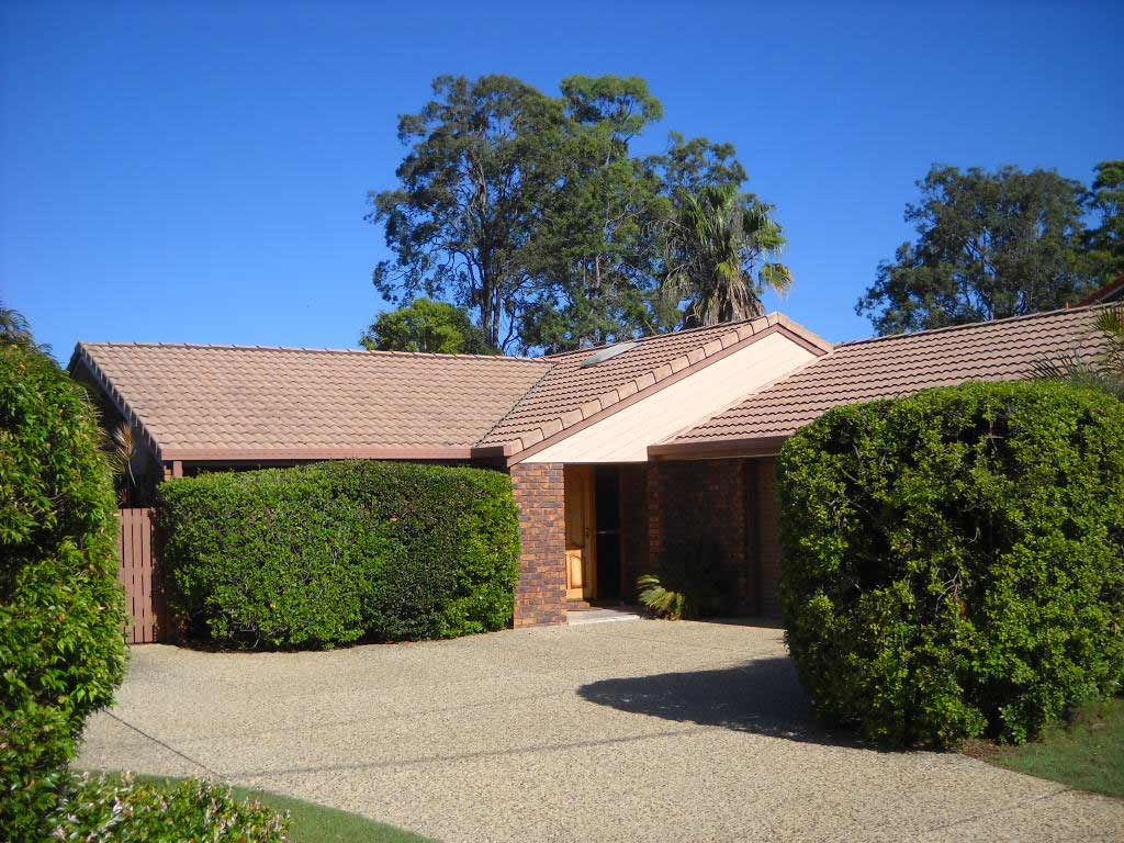 before image of roof restoration in murrumba downs with dark red roof